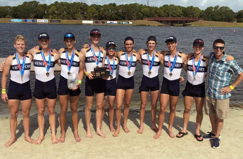 Newport Aquatic Center rowers Clay Rolfes, left, John Egan, Jake Taylor, Ryan McCarthy, Kevin Boyle, Adam McDonald, Cannon Kenney, Andrew Smith, Jackson Banta, and coach Nick D'Antoni pose after winning the men's lightweight 8+ race at the USRowing Youth National Championships.