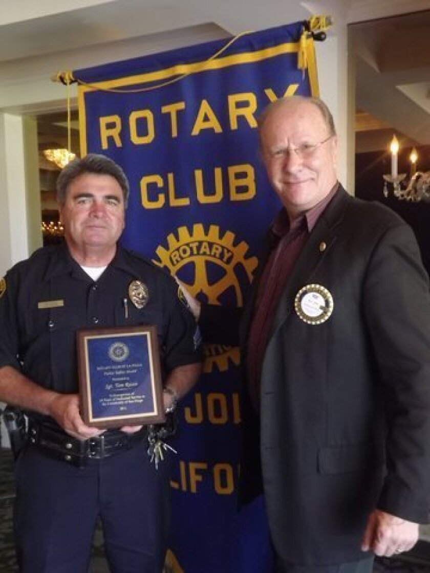 Sgt. Tom Rizzo accepts his award from Rotary President Ron Jones. Photo: Courtesy