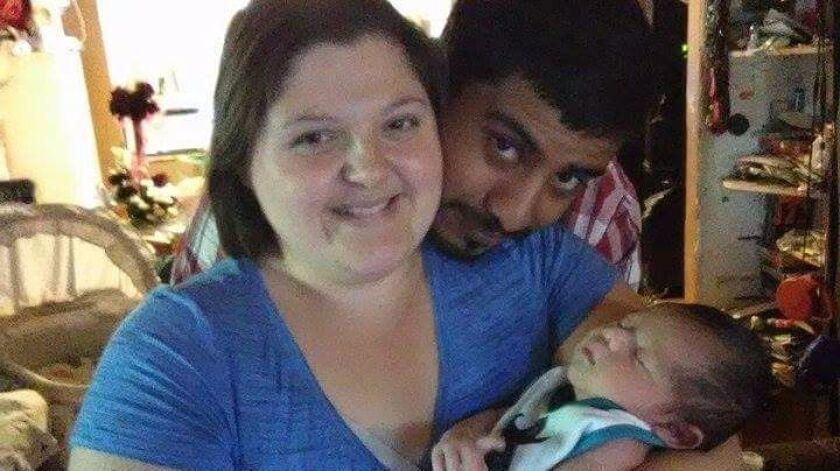 Carlos Martinez Paz with his fiancée Amanda Cresci and newborn son Carlos III.