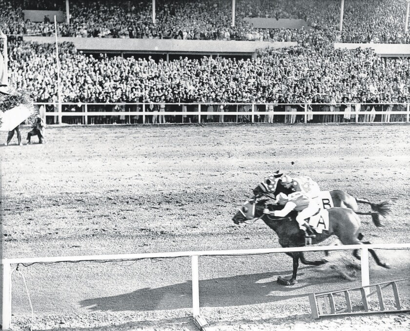 Seabiscuit and Ligaroti run neck and neck toward the finish line at the Del Mar Racetrack on Aug. 12, 1938.