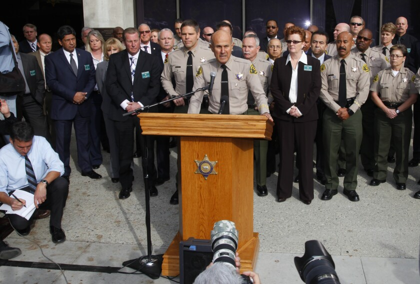 With his command staff standing behind him, L.A. County Sheriff Lee Baca announced Tuesday that he will not seek a fifth term and will instead retire at the end of January.