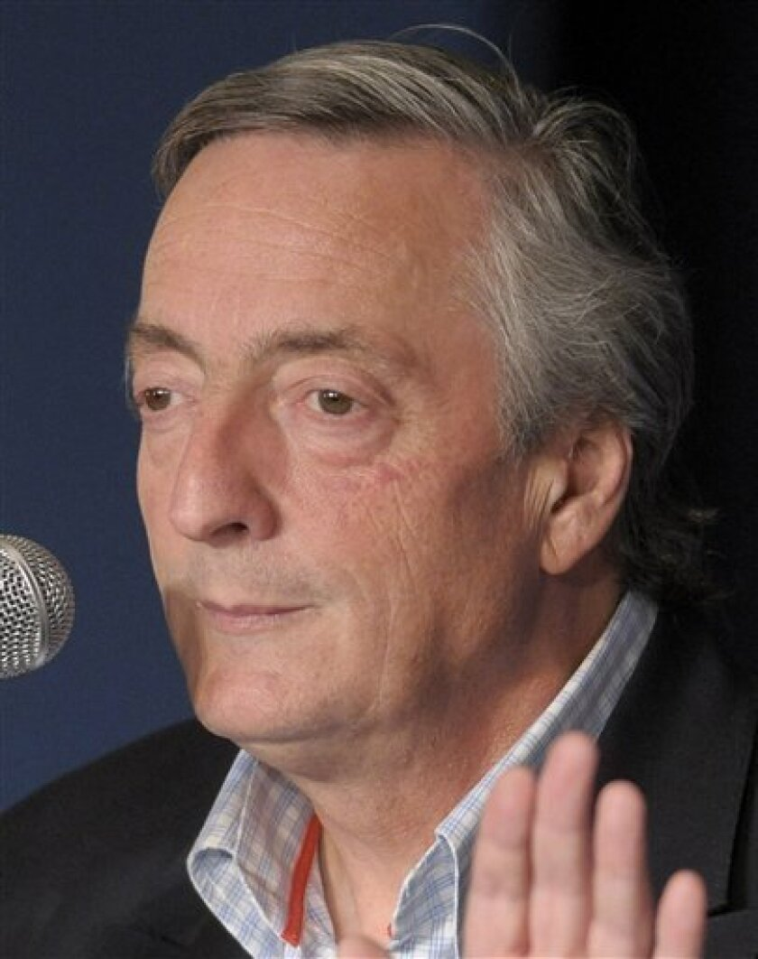 In this photo taken June 29, 2009, former Argentina's President Nestor Kirchner gestures during a press conference in Buenos Aires. Kirchner underwent emergency surgery after showing symptoms of carotid artery disease, the presidency said. (AP Photo/Daniel Luna)