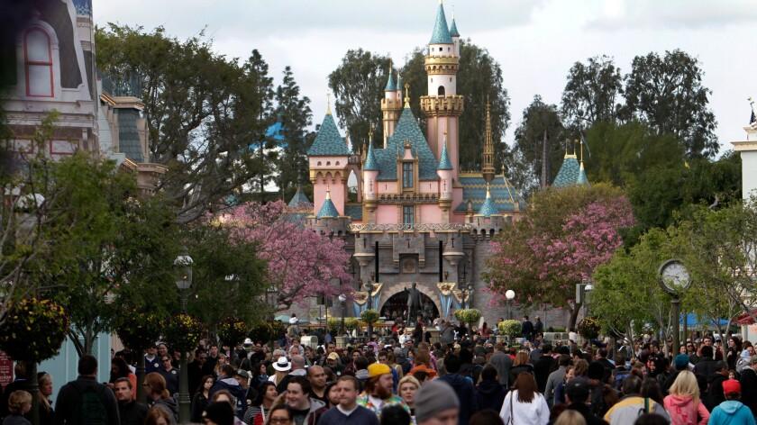 Visitors at the Magic Kingdom at Disneyland.