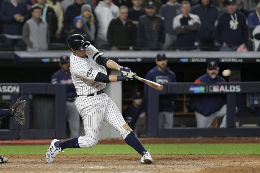 The Yankees' DJ LeMahieu hits a three-run double during Game 1 of the ALDS on Oct. 4, 2019.