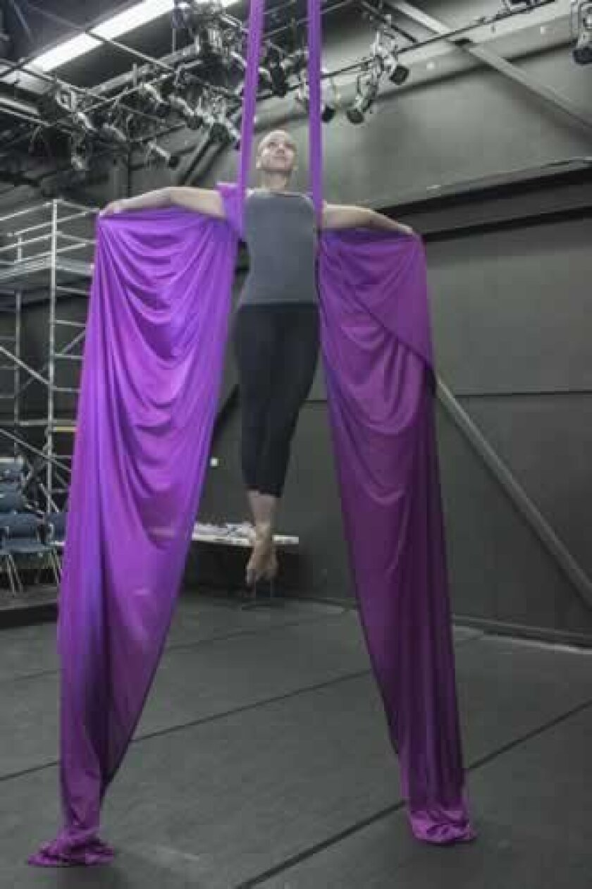 Aerialist Kiona Daelin warms up for rehearsal. Maurice Hewitt