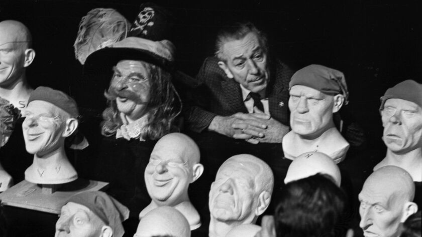 Walt Disney check out some of the heads for Pirates in 1966. It was the last ride he oversaw.