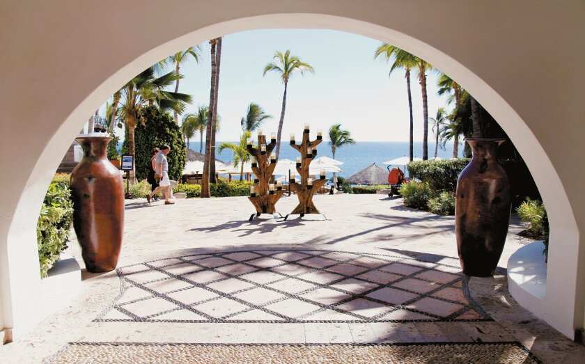 A main archway of the One & Only Palmilla leads out to the beach in Los Cabos.