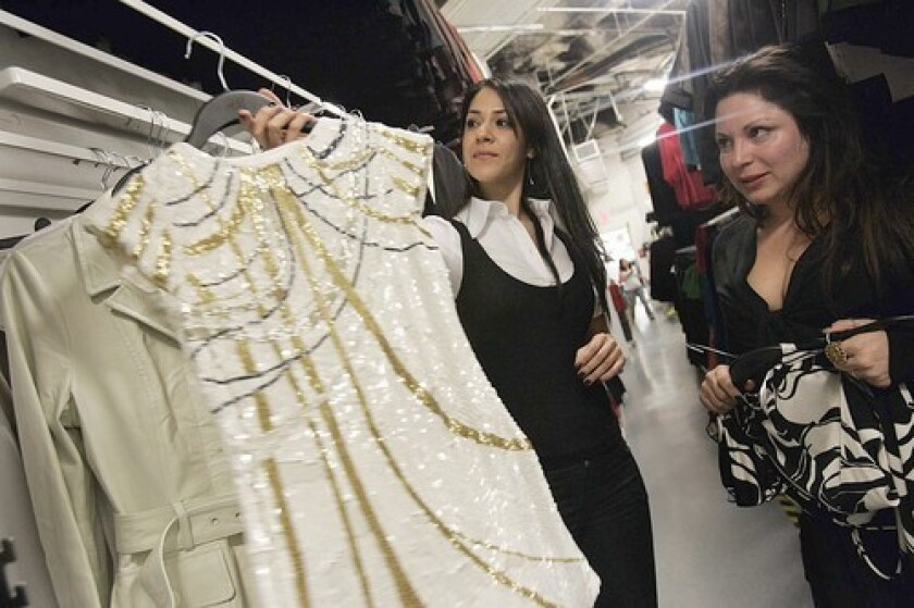 Pansy Toulou, left, shows the new M by Madonna line to Jessica Paster.