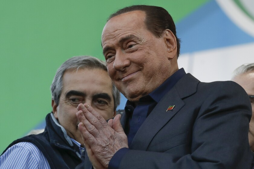 FILE - In this Oct. 19, 2019 file photo, Silvio Berlusconi addresses a rally in Rome. Italy's former prime minister and right-wing leader Silvio Berlusconi has tested positive to coronavirus after a precautionary check, his press office said on Wednesday, Sept. 2, 2020. The three-time-premier and media tycoon had been recently seen with his old-time friend and businessman Flavio Briatore, who was recently hospitalized after testing positive to Covid-19 last month. Berlusconi had tested negative at the time. (AP Photo/Andrew Medichini)