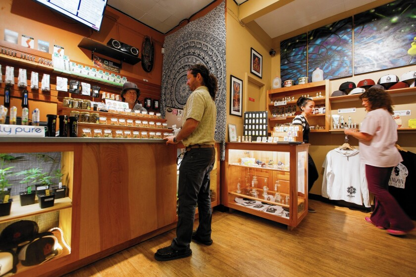 Employees of Amazon Organics sell medical marijuana to customers in Eugene, Ore. Starting Thursday, pot dispensaries in the state can also serve recreational users.