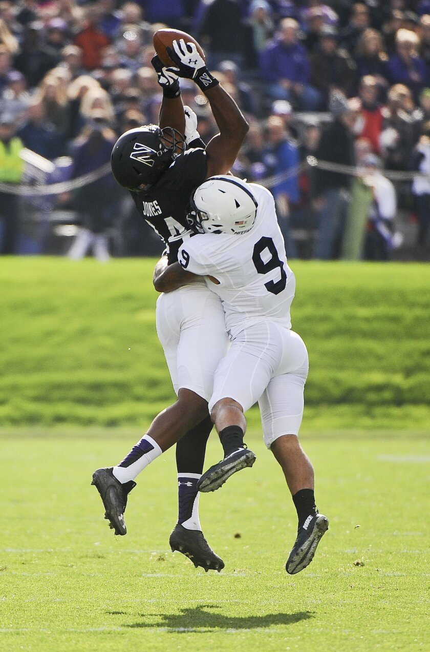 Northwestern wide receiver Christian Jones (14)  makes a catch against Penn State safety Jordan Lucas (9) during the first quarter of an NCAA college football game in Evanston, Ill.,  Saturday, Nov. 7, 2015. (AP Photo/Matt Marton)