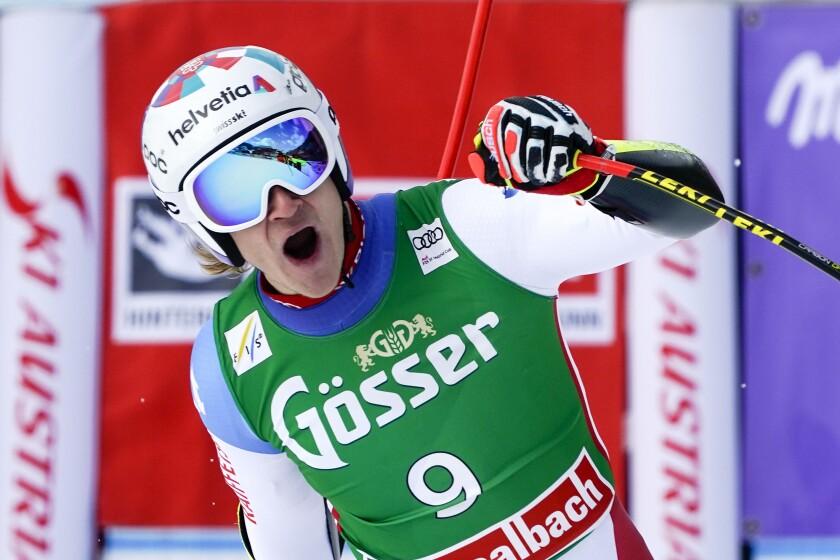 Switzerland's Marco Odermatt celebrates at the finish area of an alpine ski, men's World Cup super G, in Saalbach-Hinterglemm, Austria, Sunday, March 7, 2021. (AP Photo/Giovanni Auletta)