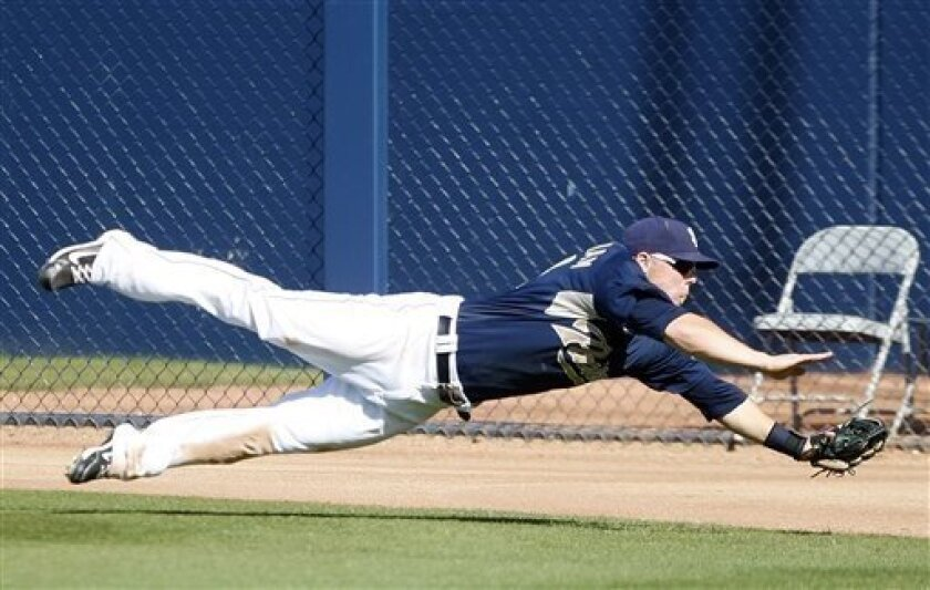 Padres right fielder Aaron Cunningham robs the Angels' Freddy Sandoval with a diving catch in the right field corner that saved a run in the seventh inning of a spring training game Tuesday in Peoria, Ariz. (AP Photo/Lenny Ignelzi)