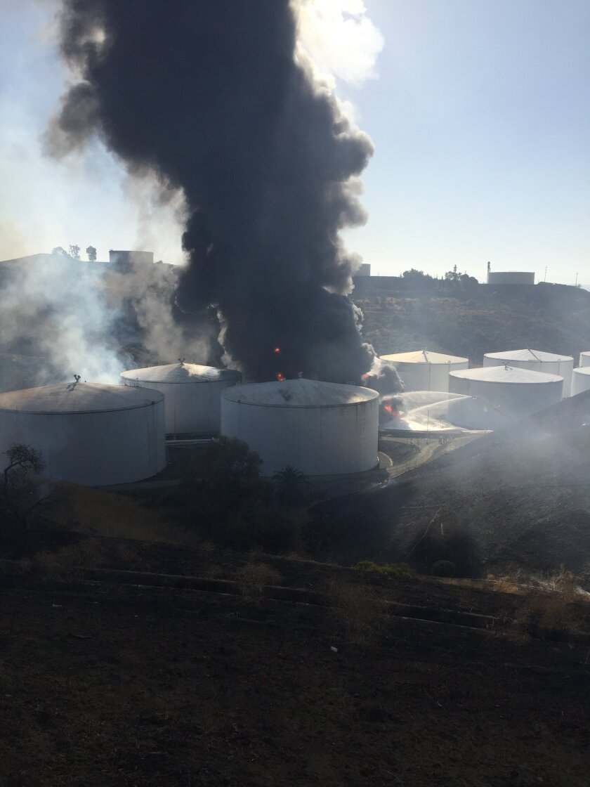 Tanks of chemicals burning at energy facility in the Bay Area prompt road closures
