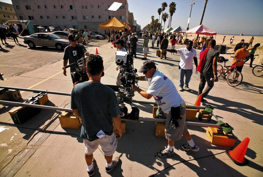 "Under a program enacted in 2009, California allocates $100 million annually to film and TV productions, which are eligible for up to a 25% tax credit toward qualified production expenses. Above, a 2010 film shoot of ""NCIS: Los Angeles."""