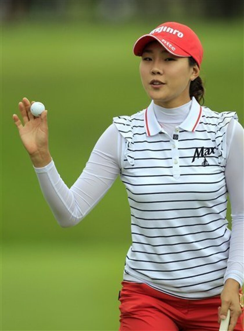 Hee Kyung Seo, of South Korea, acknowledges the crowd on the 18th green during the second round of the Jamie Farr Toledo Classic at the Highland Meadows Golf Club in Sylvania, Ohio, Friday, Aug. 10, 2012. (AP Photo/Carlos Osorio)