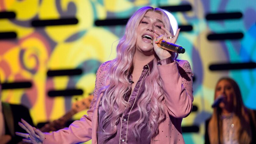 "Kesha is expected to perform her song ""Praying"" on Sunday's Grammy Awards."