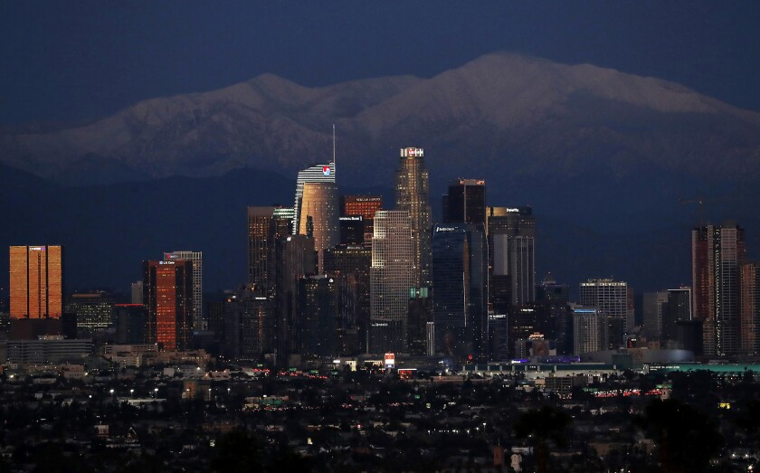 Snow covers the San Gabriel Mountains with downtown L.A. in the foreground in February of 2019