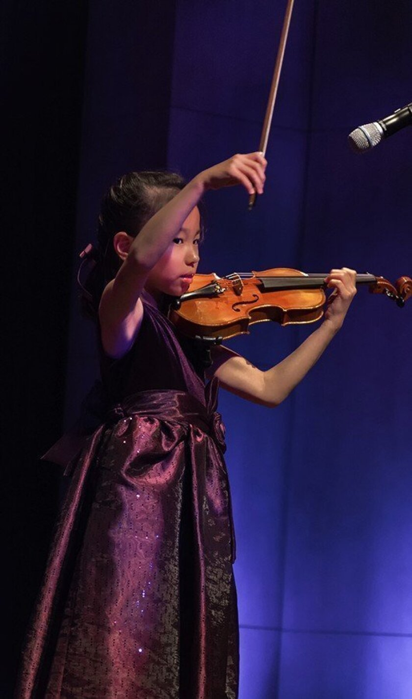 Minji Kim, a Del Mar Heights student, performs at Heart of a Child.