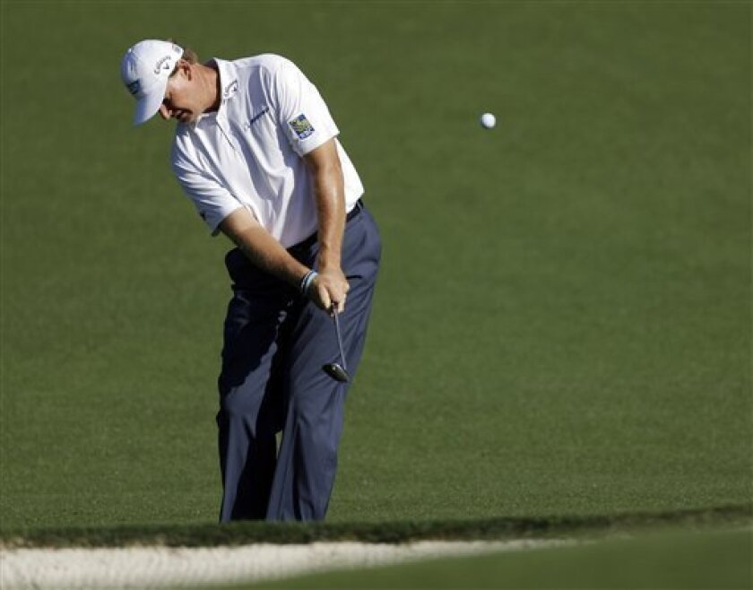 Ernie Els, of South Africa, chips to the fourth green during a practice round for the Masters golf tournament Wednesday, April 10, 2013, in Augusta, Ga. (AP Photo/David Goldman)