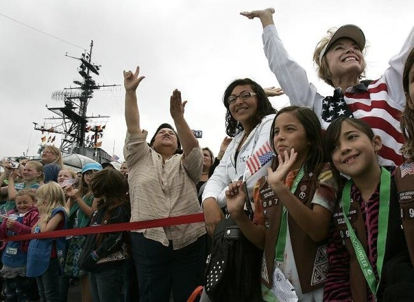 Girl scouts and their parents and local dignitaries gathered on the deck of the USS Midway on Saturday, May 7, 2011 to celebrate the 10th anniversary of Operation Thin Mint, which lets customers buy cookies but designate them for shipment overseas to U.S. military personnel.