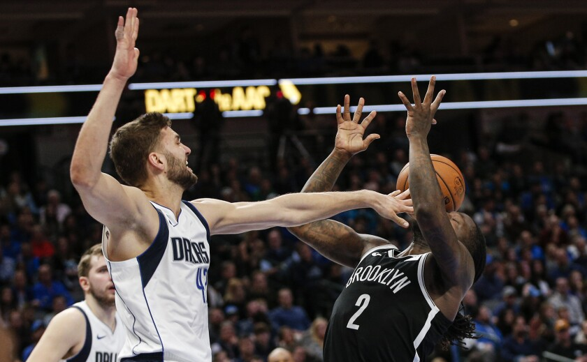 Mavericks power forward Maxi Kleber blocks a shot by Nets forward Tuarean Prince during a game on Jan. 2, 2020, in Dallas.