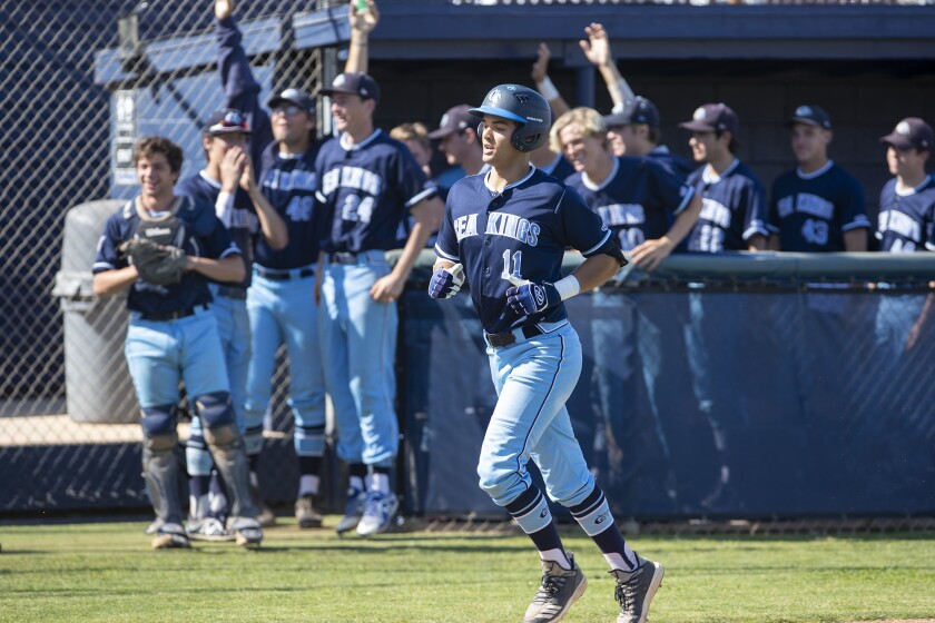 Corona del Mar's Reece Berger trots home after hitting a home run in the third inning during a Wave League game on April 16.