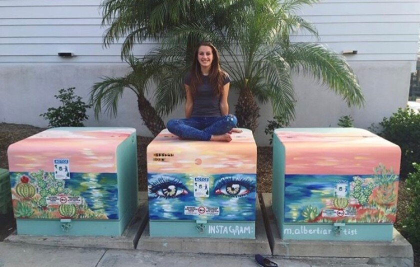 Marina with her electrical boxes in Cardiff.