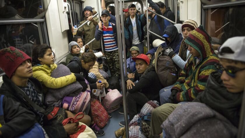 Central American migrants ride on the subway after leaving the temporary shelter at the Jesus Martin