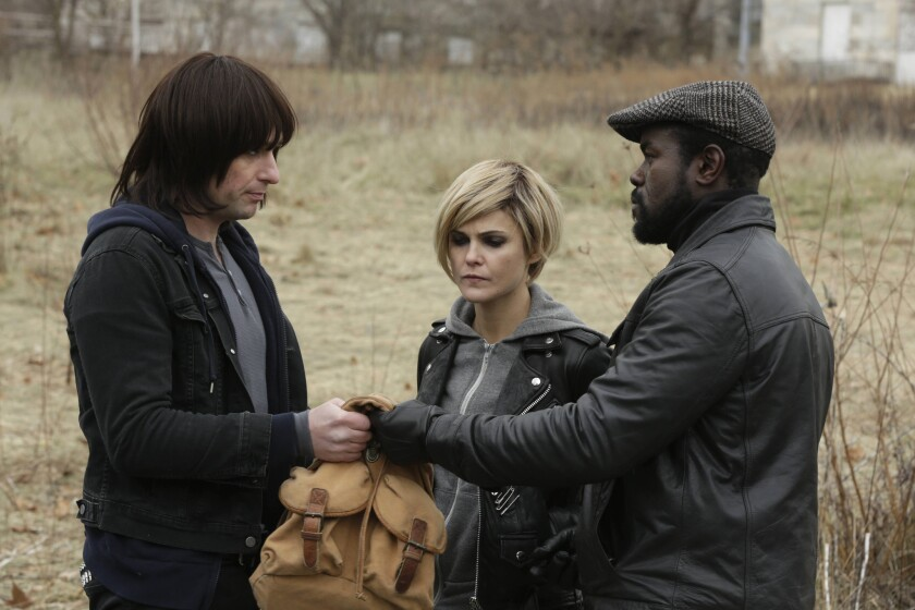 """KGB spies Philip (Matthew Rhys) and Elizabeth Jennings (Keri Russell) work with South African freedom fighter Reuben Ncgobo (Dwayne Alistair Thomas), right, to head off a plot against the anti-apartheid movement on """"The Americans."""""""