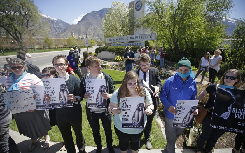 Protesters stand in solidarity with rape victims on the campus of Brigham Young University during a sexual assault awareness demonstration in Provo, Utah on April 20.