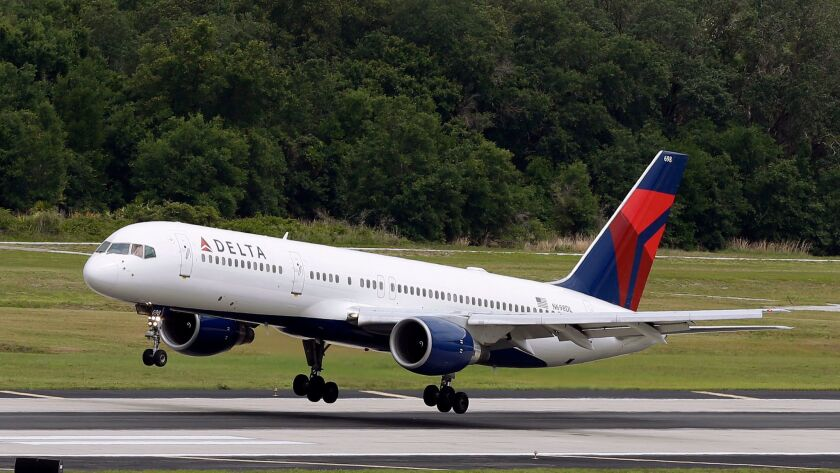 Delta Air Lines said the LAX kitchen operated by Gate Gourmet complies with local and federal regulations. Above, a plane takes off in Florida.