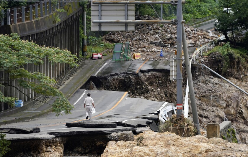 A flood-damaged road in Kumamura, Japan, on Monday.