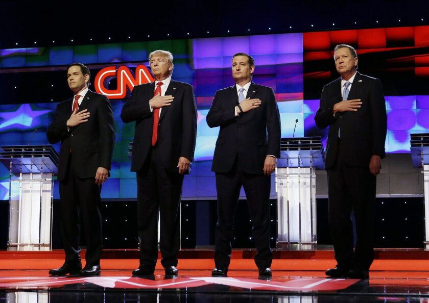 Republican presidential candidates, Sen. Marco Rubio, R-Fla., from left, Donald Trump, Sen. Ted Cruz, R-Texas, and Ohio Gov. John Kasich, stand together during the signing of the National Anthem, before the start of the Republican presidential debate sponsored by CNN, Salem Media Group and the Wash