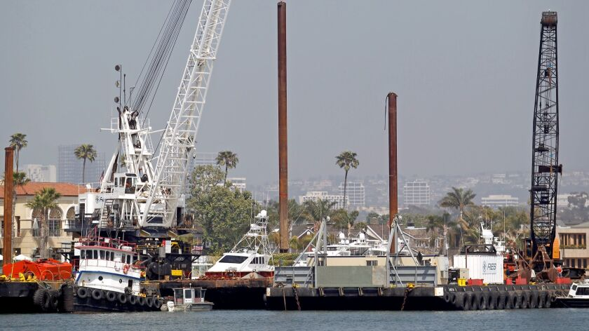 Dredging begins in Newport Harbor at the southern tip of Lido Island Tuesday, May 8.