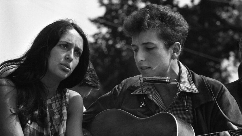 "Joan Baez (left) was ""an enchantress,"" Bob Dylan says in a new interview on his website. ""She'd make you forget who you were."""