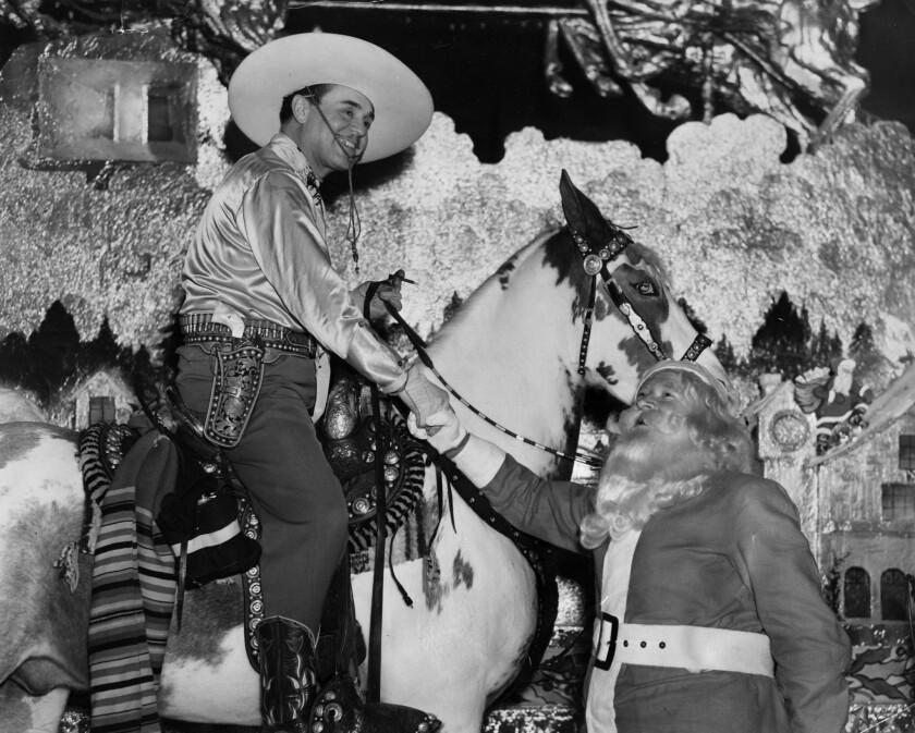 Santa Claus greets actor Leo Carrillo on Santa Claus Lane in Hollywood.