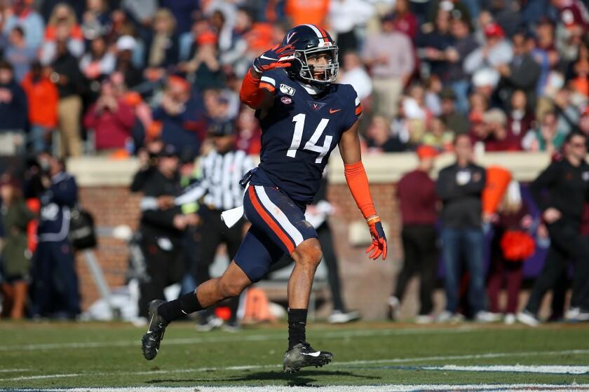 Virginia linebacker Noah Taylor celebrates a stop on defense during a 39-30 victory over No. 23 Virginia Tech on Friday.
