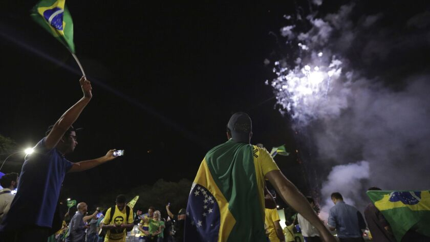 Demonstrators celebrate after former Brazilian President Luiz Inacio Lula da Silva lost his bid to remain free while he appeals a corruption conviction. Lula leads the polls in the upcoming presidential race.