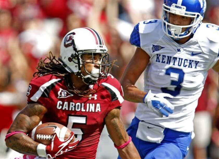 South Carolina cornerback Stephon Gilmore (5) looks upfield in front of Kentucky wide receiver Matt Roark (3) after an interception during the first quarter in an NCAA college football game at Williams Brice Stadium on Saturday, Oct. 8, 2011, in Columbia, S.C. (AP Photo/Rich Glickstein)