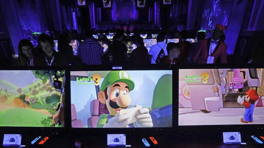 "LOS ANGELES, CA -- JUNE 11, 2019: Nintendo's ""Luigi's Mansion 3"" display and demonstration booth dur"