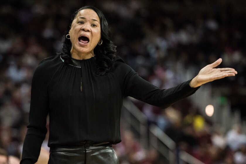 South Carolina head coach Dawn Staley communicates with an official during the first half of an NCAA college basketball game against LSU Sunday, Feb. 28, 2016, in Columbia, S.C. (AP Photo/Sean Rayford)