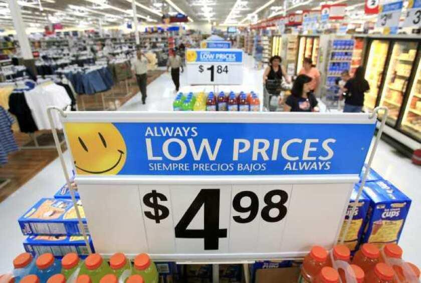 Wal-Mart announces improving sales but a drop in profit