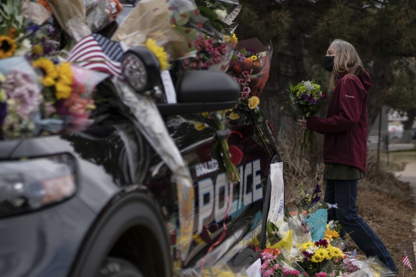 Mourners pay respects to police officer.