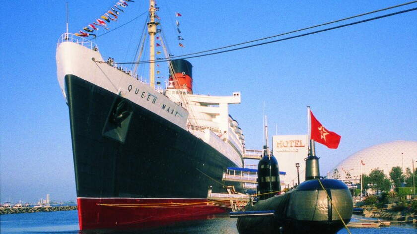 The Scorpion submarine is docked next to the Queen Mary in Long Beach. In a lawsuit, the Scorpion's owner claims that the operator of the Queen Mary failed to maintain the sub as agreed.