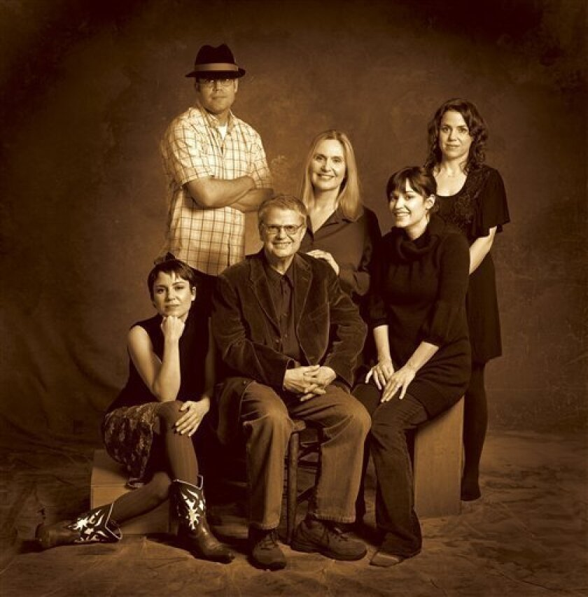 This undated photo shows bass great Charlie Haden, center, as he poses with his wife Ruth Cameron, third from right, his son Josh, second from left, and triplet daughters, from left to right, Rachel, Tanya and Petra. (AP Photo/Universal Music Group)