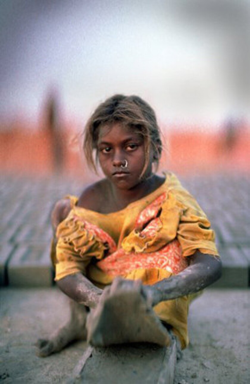 """The 2005 documentary movie """"Stolen Childhoods"""" showed an enslaved, 9-year-old girl working at a brick kiln in West Bengal, India."""