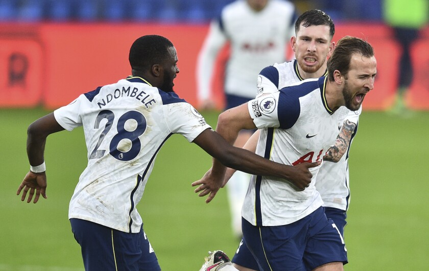 Tottenham's Harry Kane, right, celebrates with teammates after scoring the opening goal of the game during their English Premier League soccer match between Crystal Palace and Tottenham Hotspur at Selhurst Park in London, Sunday, Dec., 13, 2020. (Glyn Kirk/ Pool via AP))
