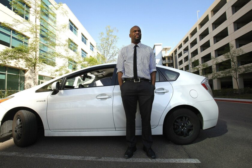 "Oak Park resident Laurence Brown works roughly 60 hours a week as an independent contractor in what's sometimes called the ""gig economy."" Brown drives a car that he leases through Uber's Xchange Leasing program."
