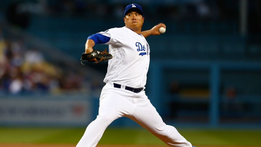 LOS ANGELES, CALIF. - APRIL 02: Los Angeles Dodgers starting pitcher Hyun-Jin Ryu (99) picthces agai
